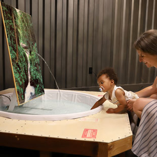woman and infant explore a culture at GLEAN 2019