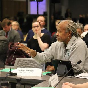 Task force member Michael Alexander speaking before vote.