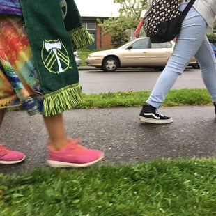 Middle school students walk along a completed sidewalk