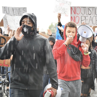 young leaders march during a Black Lives Matter protest