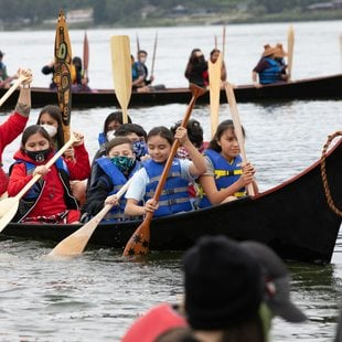 Portland All Nations Canoe Family rowing in a canoe together in the Columbia River