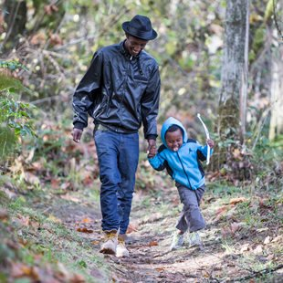 man and boy walking on trail at Oxbow Regional Park