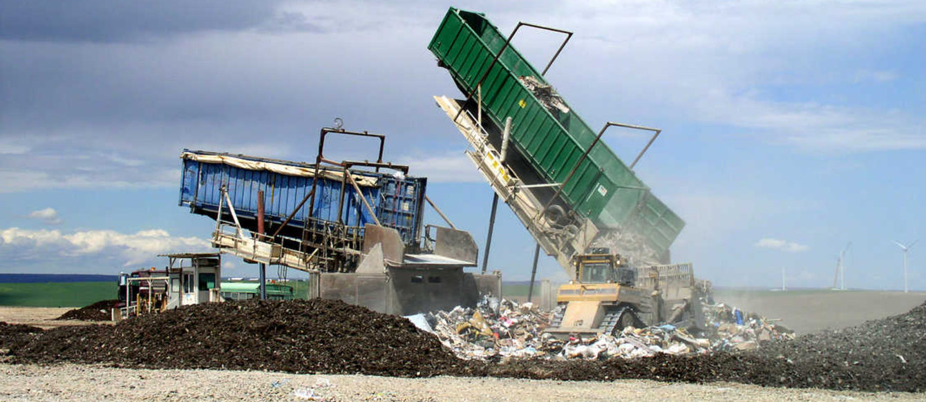 photo of a load of waste being emptied at a landfill