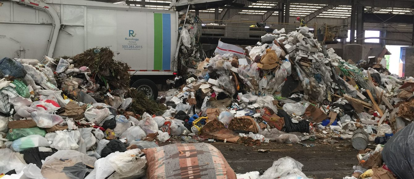 garbage truck emptying its load at Metro's Central transfer station