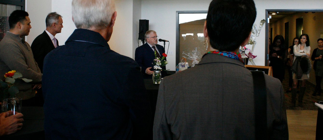 Metro Council president Tom Hughes addresses the crowd gathered for the Hub 9 Grand Opening