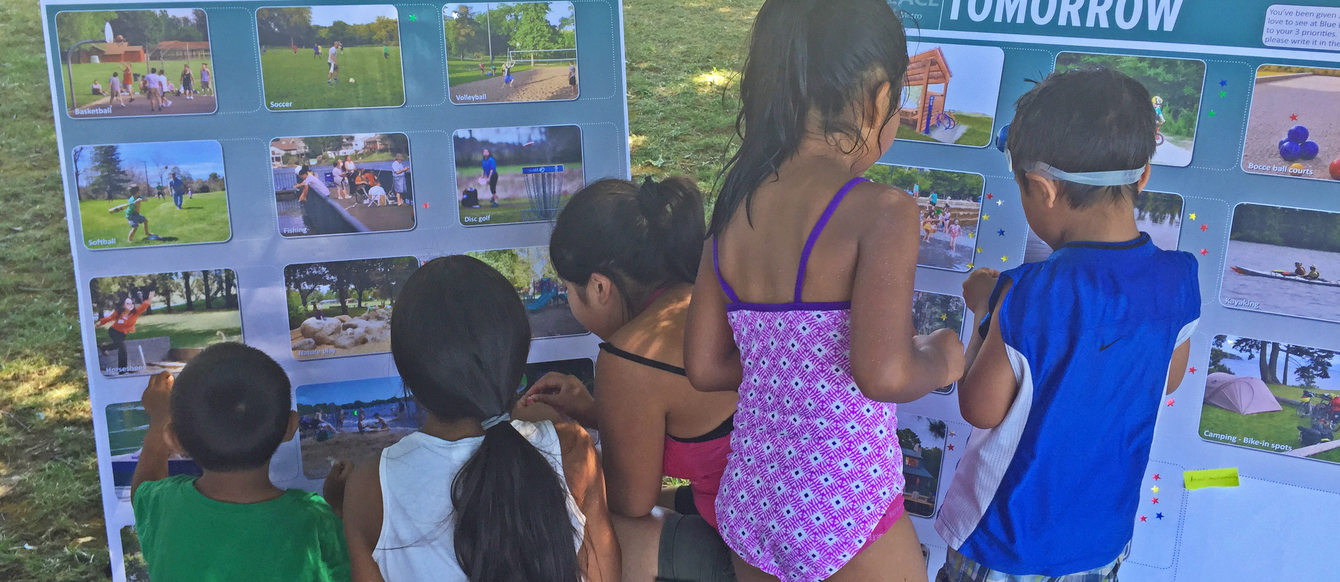 children viewing images of proposed improvements to Blue Lake Park