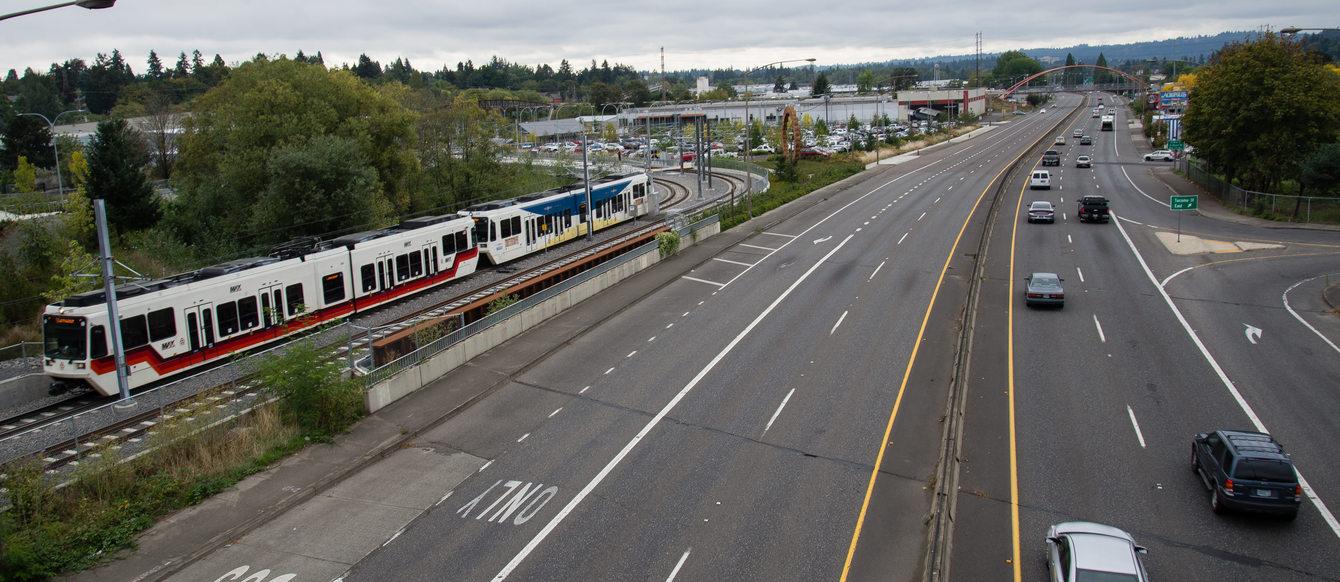Image of MAX train alongside freeway