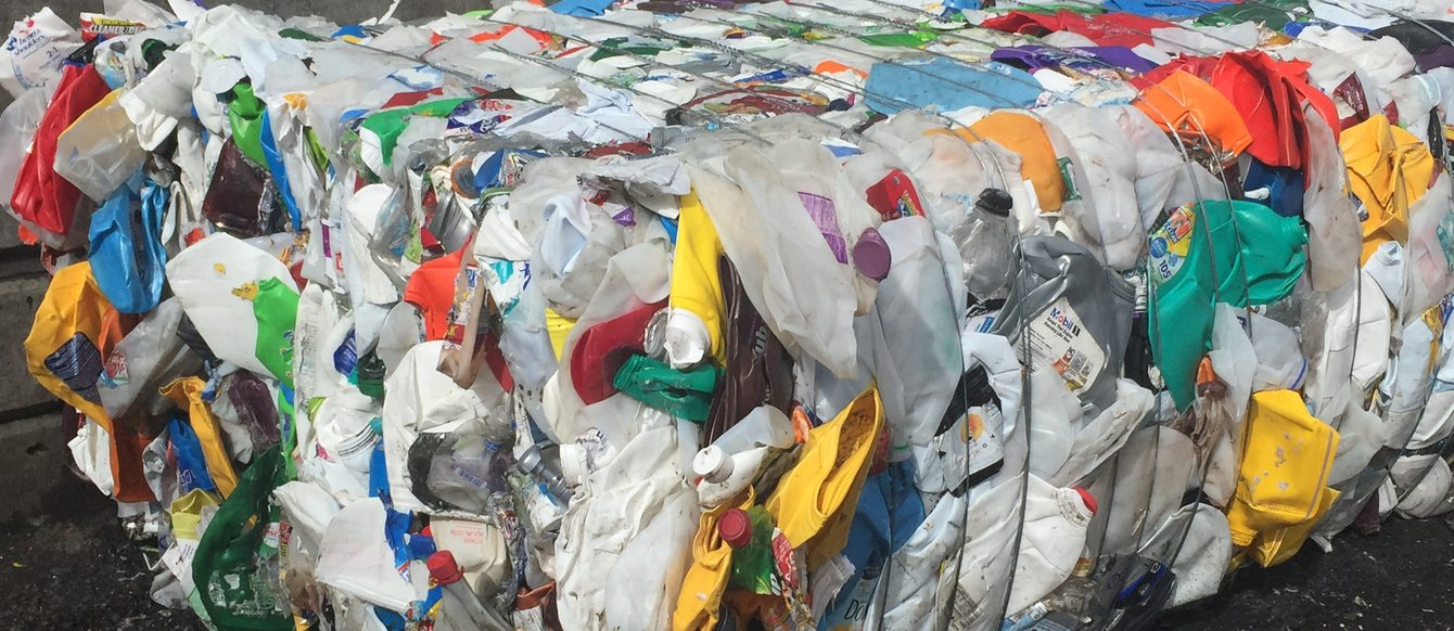 photo of plastic items baled for recycling