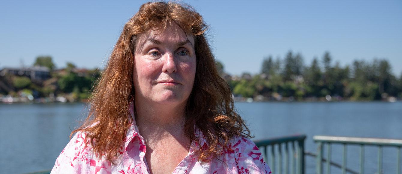 Patricia Kepler on the fishing dock at Blue Lake Regional Park