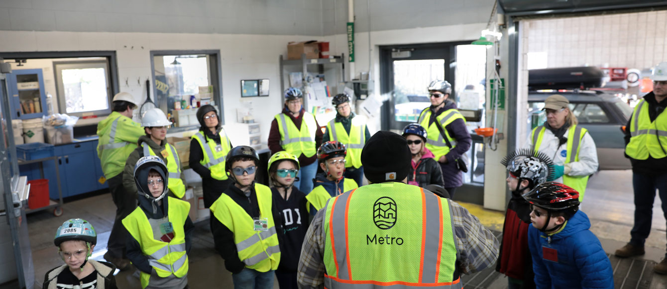 a group of kids steps inside a hazardous waste facility