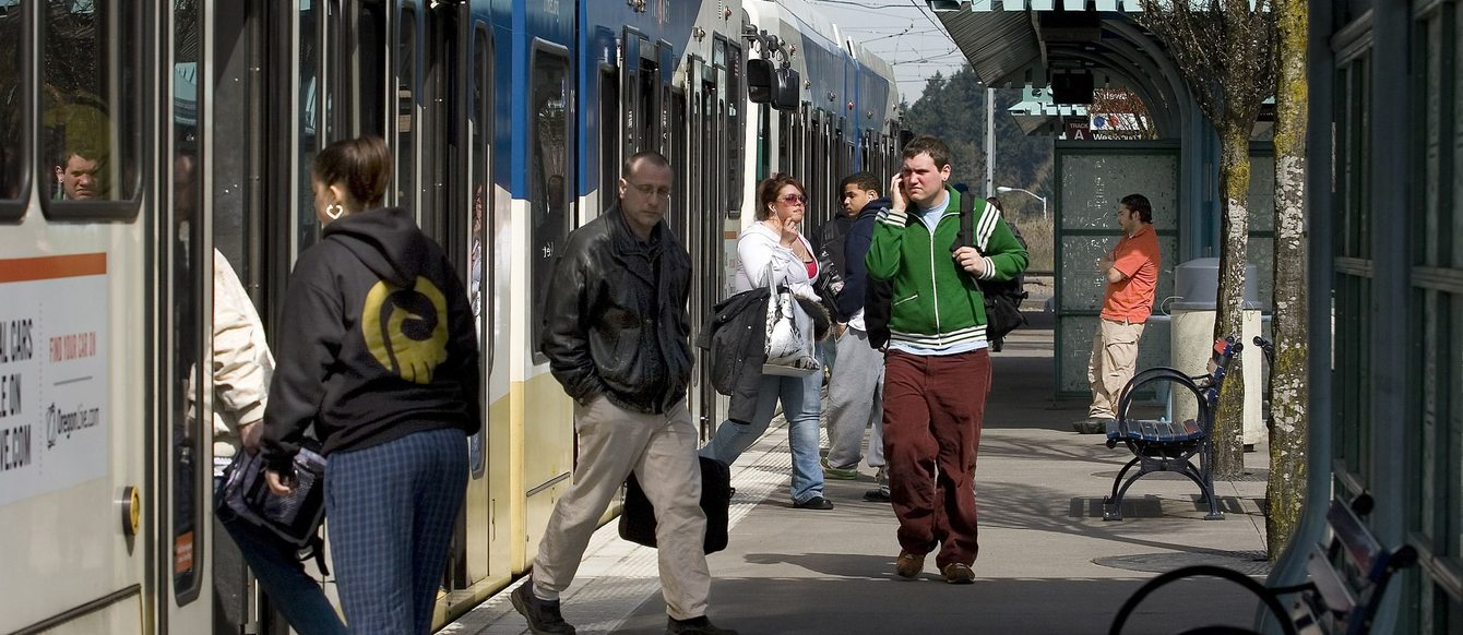 riders entering and exiting a MAX light rail train