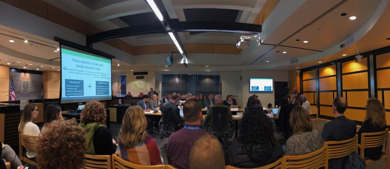 Attendees watch Metro Council work session in progress
