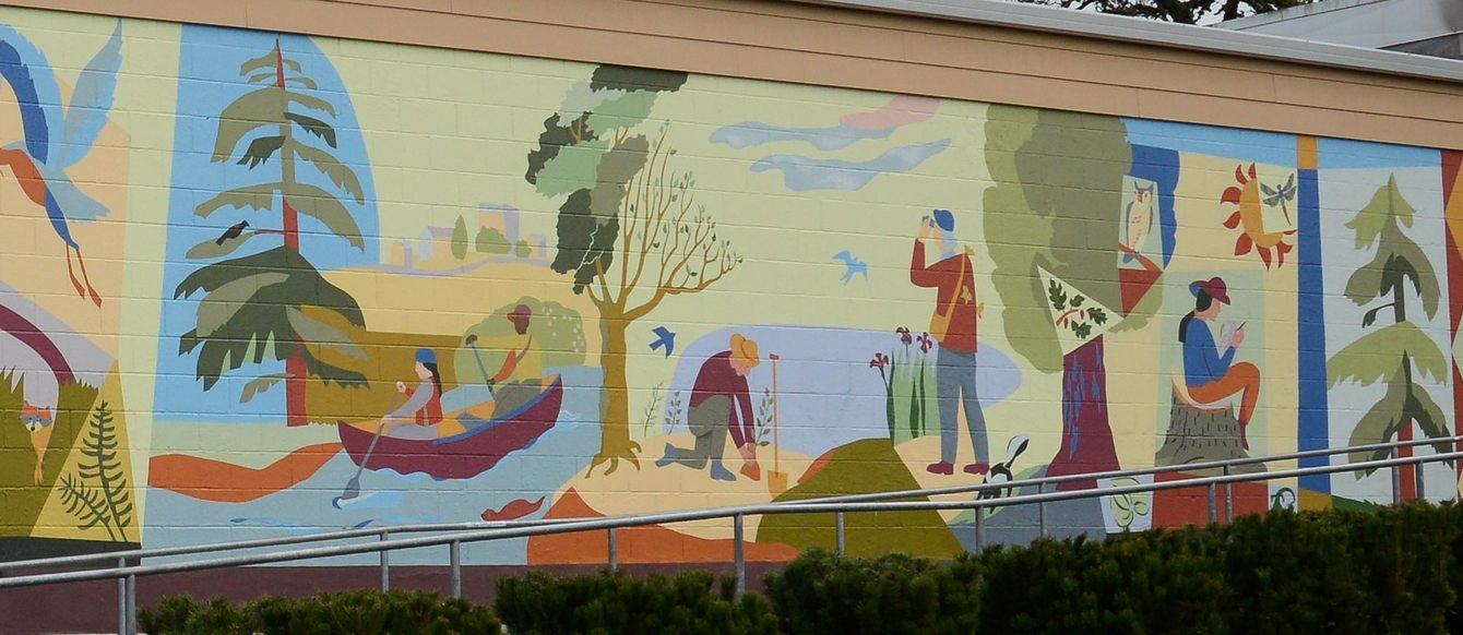 Mural depicting people working together along a river