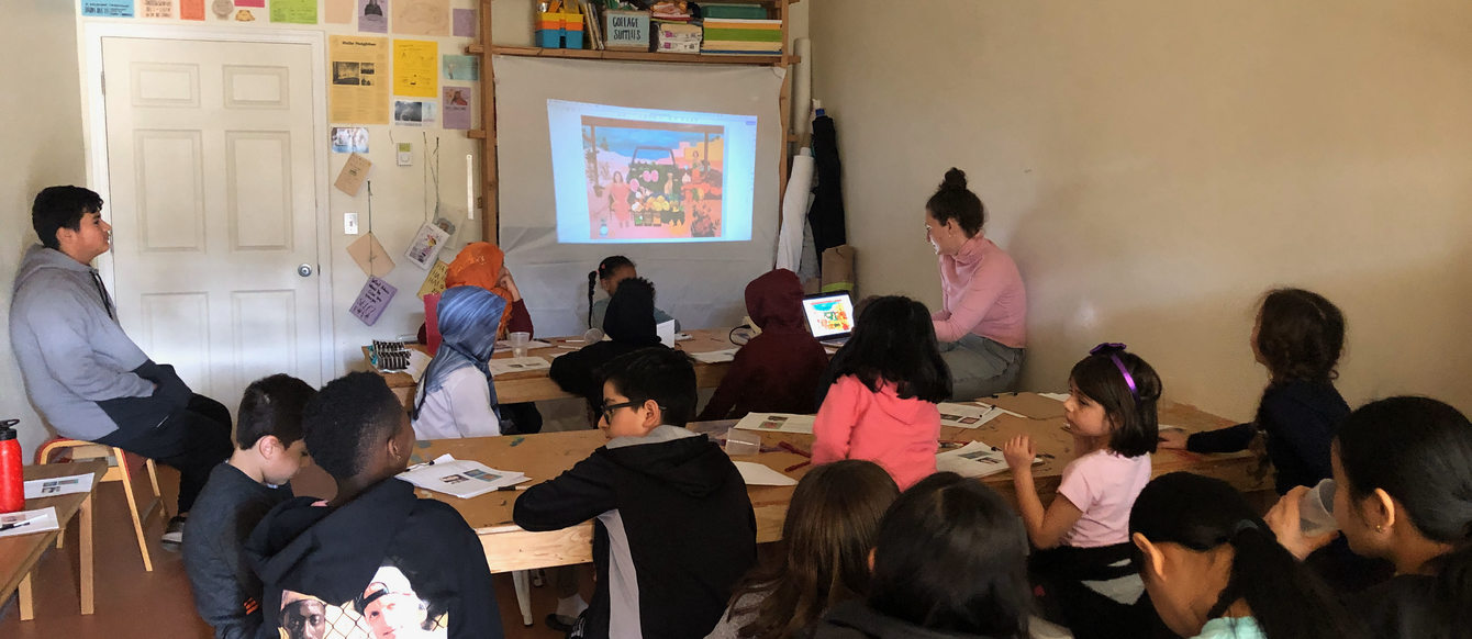 group of young children participate in an art class