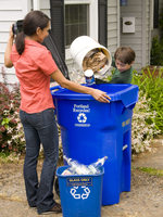 photo of mom and son emptying the recycling bin