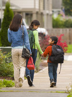 photo of mom and kids walking to school
