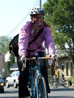 photo of a woman biking