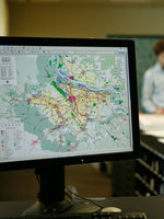 photo of monitor and maps