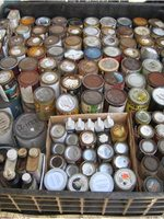 photo of discarded paint cans
