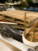 wood waste loaded into the bed of a pickup
