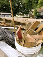 Treated wood in the back of a pickup truck.