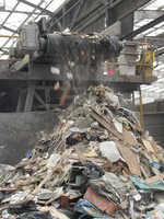 Unsalvageable dry waste drops off the end of the line where it has been picked through and sorted by Recology employees.