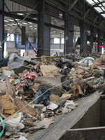 Recology workers sort through dry waste, pulling all recyclables from the waste stream. All dry waste at the facility goes through this process.