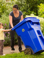 photo of mother and daughter recycling