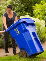 Image of mom and child with recycling bin