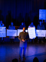 Actors on stage recreating the March on Washington and Dr. Martin Luther King, Jr.'s