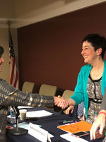 Betty Dominguez shaking hands with Metro councilors Kathryn Harrington and Craig Dirksen