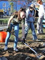 photo of children planting trees at M&M Marketplace
