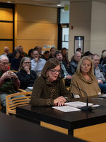 A woman speaks at a public hearing at the Metro Council