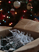 close up of a box with holiday string lights