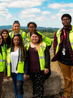 group shot of garbage and recycling interns and staff in neon vests