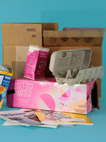 collection of different types of paper and cardboard that can be recycled at curbside
