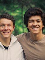 two boys in a shoulder-to-shoulder embrace