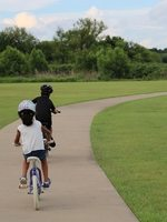 Young children bicycling on a path