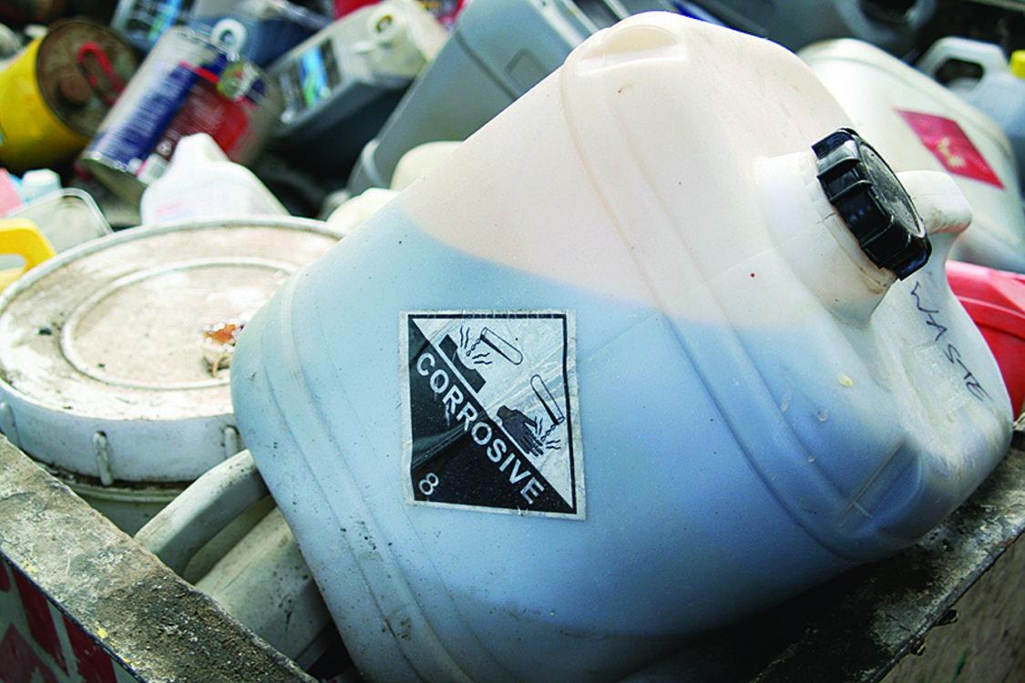photo of corrosive hazardous waste tub