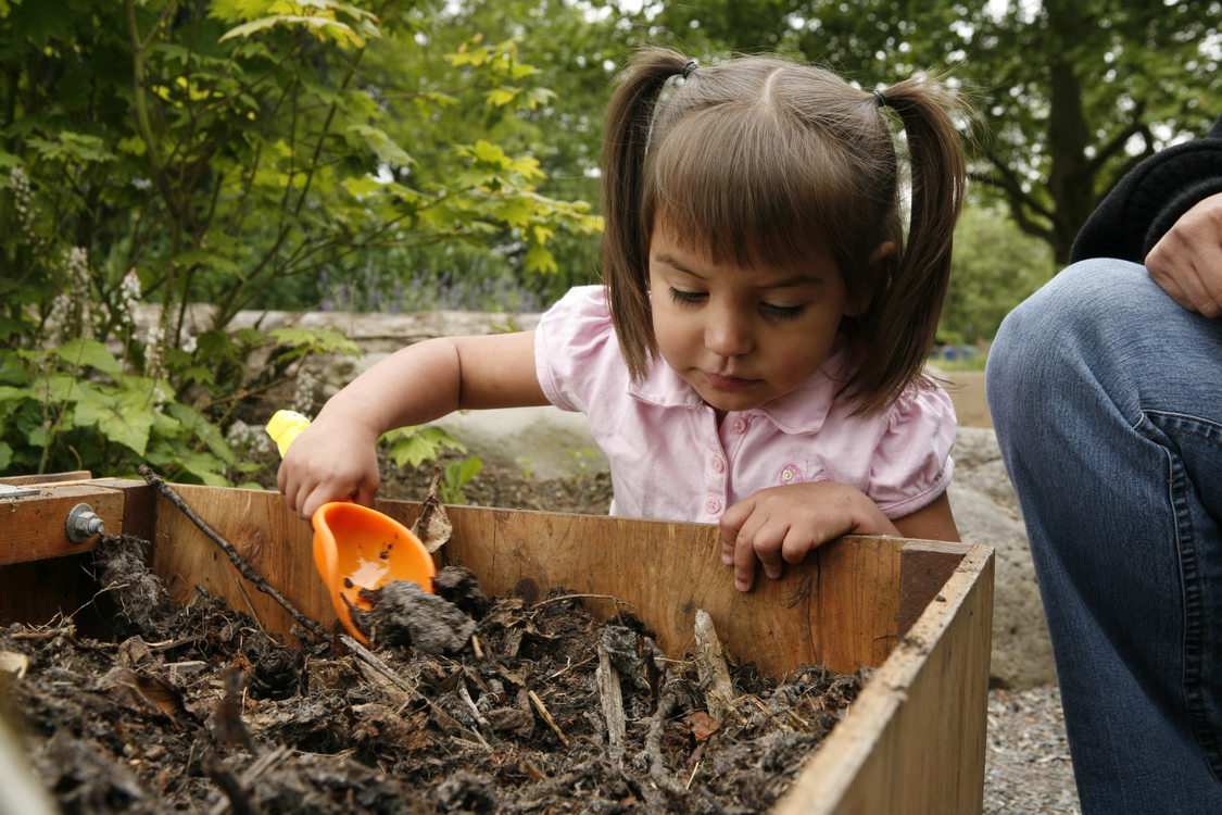photo of a girl playing in the Blue Lake Natural Discovery Garden