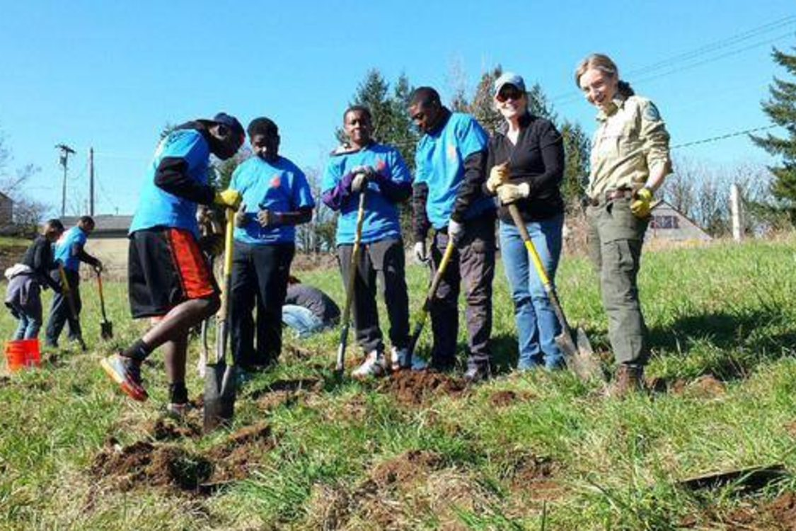photo of Self Enhancement, Inc. student volunteers planting trees at North Abbey Creek Natural Area
