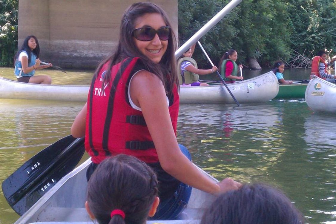 girl wearing sunglasses in canoe
