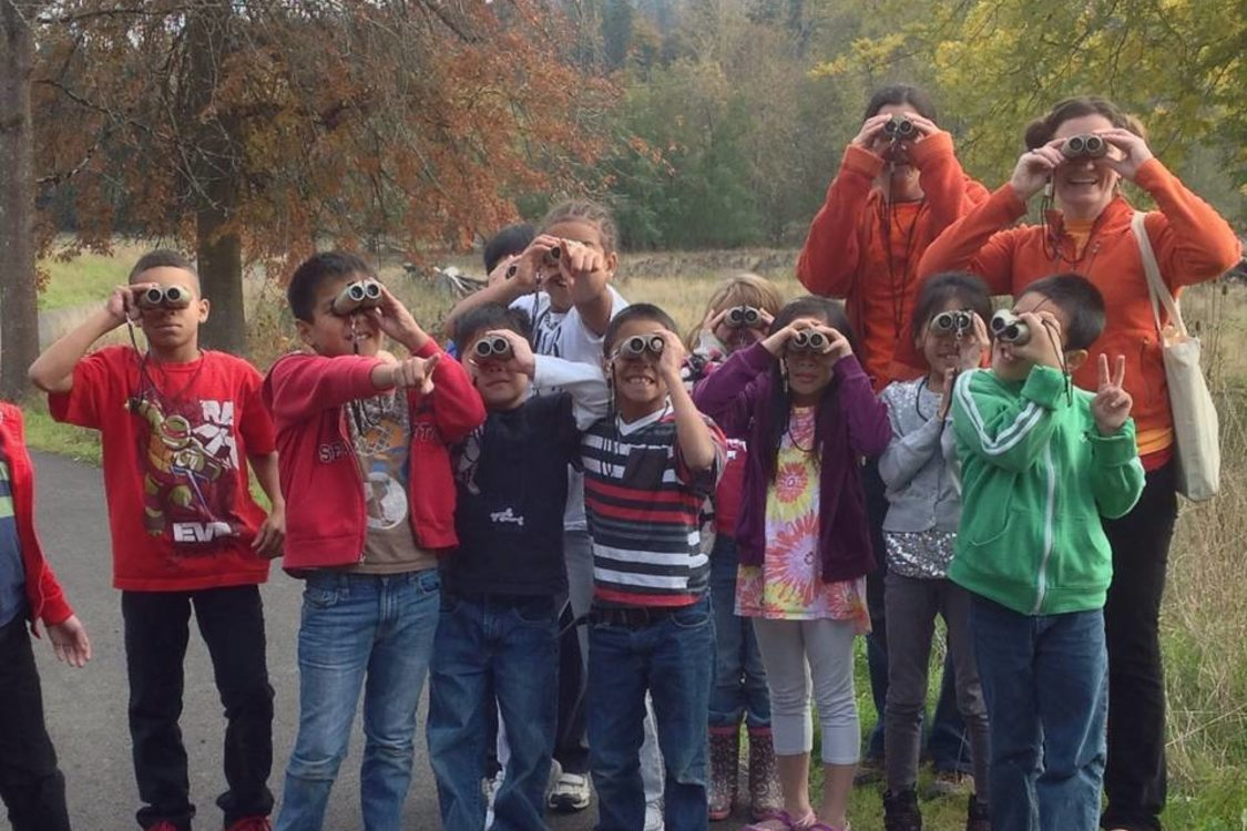 children and teachers from Ecology in Classrooms using binoculars