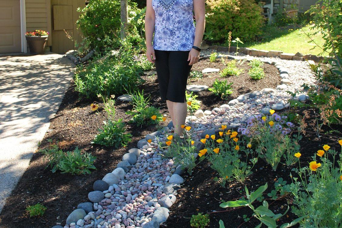 photo of Susan Spencer in her Gresham yard