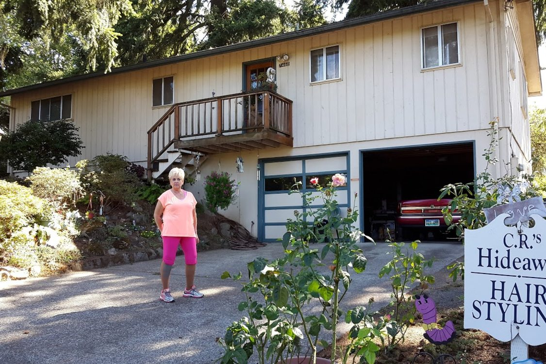 Carole Rovig in front of her house