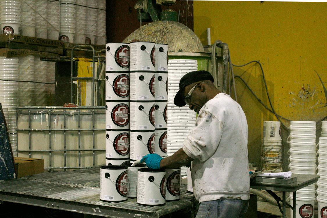 Paint cans are filled with recycled paint at MetroPaint's Swan Island facility on Oct. 30, 2015.