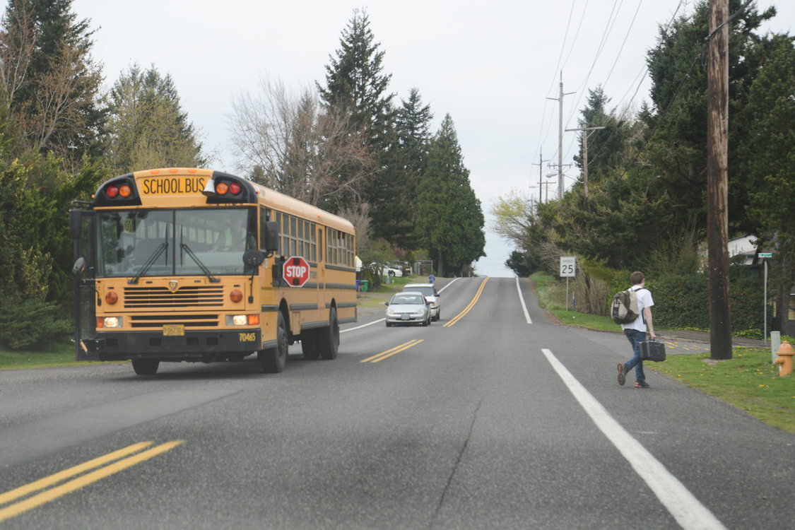 Student getting off school bus in Gresham