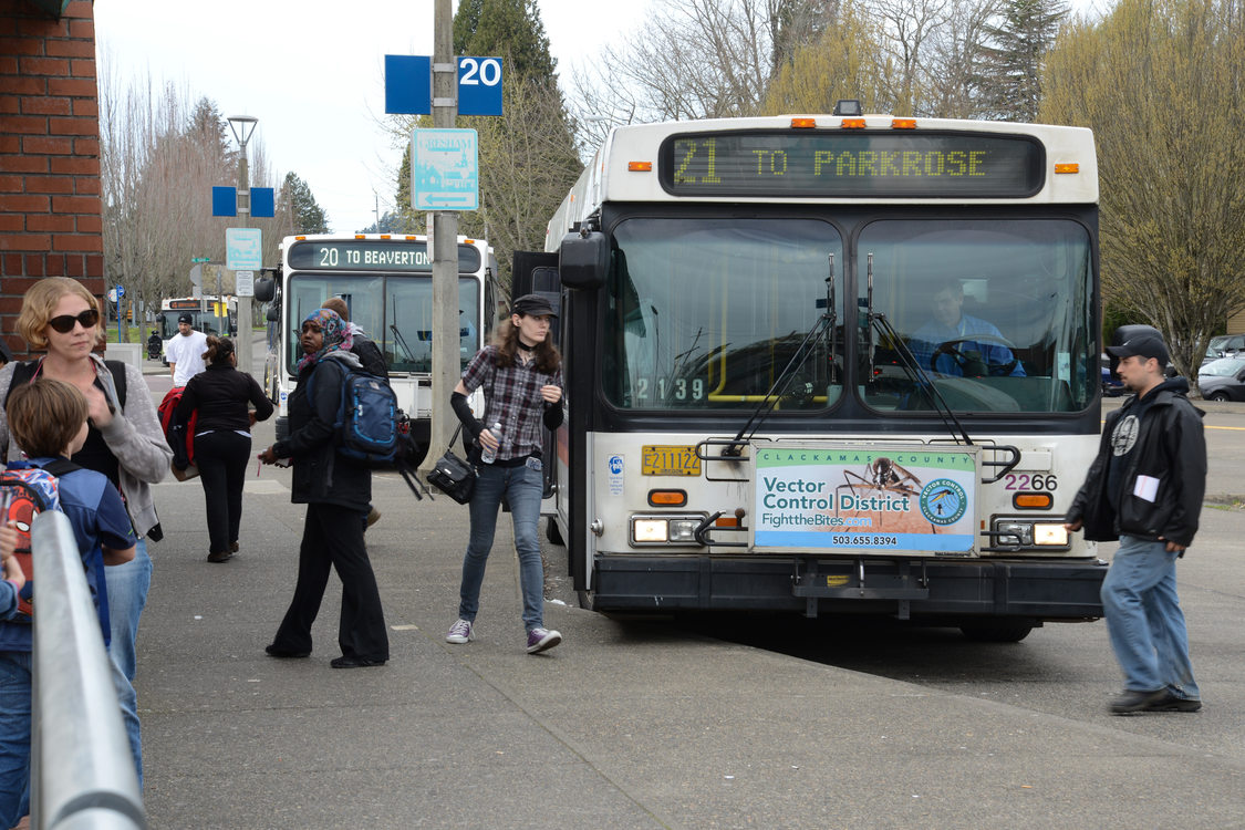 Gresham Transit Center bus and riders
