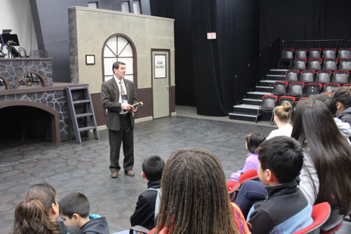 Event services manager Joe Durr shares stories of different theater opportunities with Marathon Scholars in Brunish Theatre in the Portland'5 Centers for the Arts.
