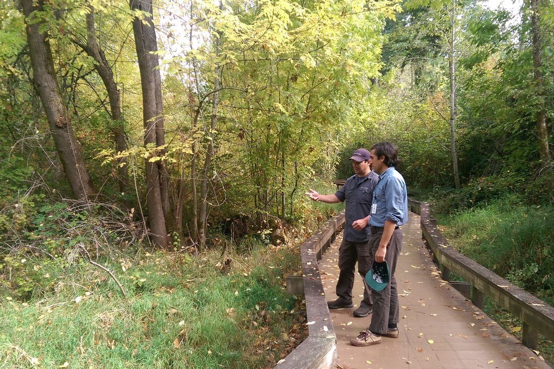 photo of two men on wooden bridge path at Willow Creek